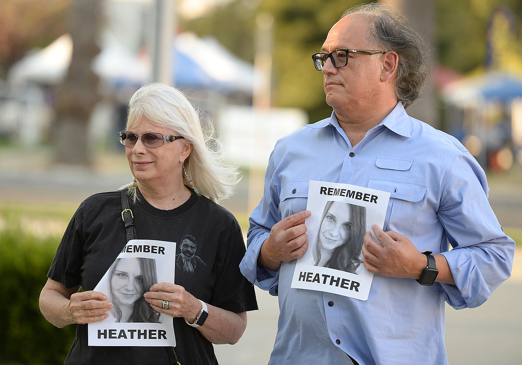 . Sandy and George Paz of Green Valley pictures of Heather Heyer who was killed last Saturday n Charlottesville, Virginia., after she was hit by a vehicle driven by a white supremacist during a Unite Against Hate Vigil Thursday in Fairfield. Nearly 100 people attended the rally at the Solano County Government Center  which was sponsored by the Jewish Caucus of the California Young Democrats and the Solano County Democratic Party. Joel Rosenbaum -- The Reporter