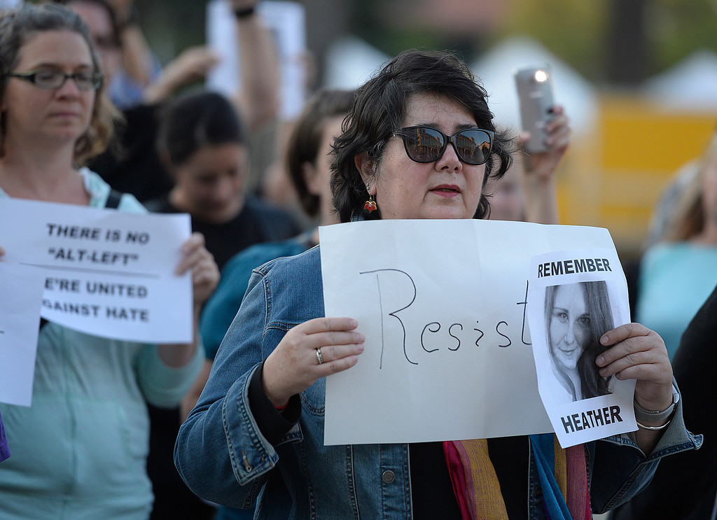 . Nearly 100 people stand in solidarity for people of Charlottesville, Va. especially Heather Heyer Thursday at the Solano County Government Center. Joel Rosenbaum -- The Reporter