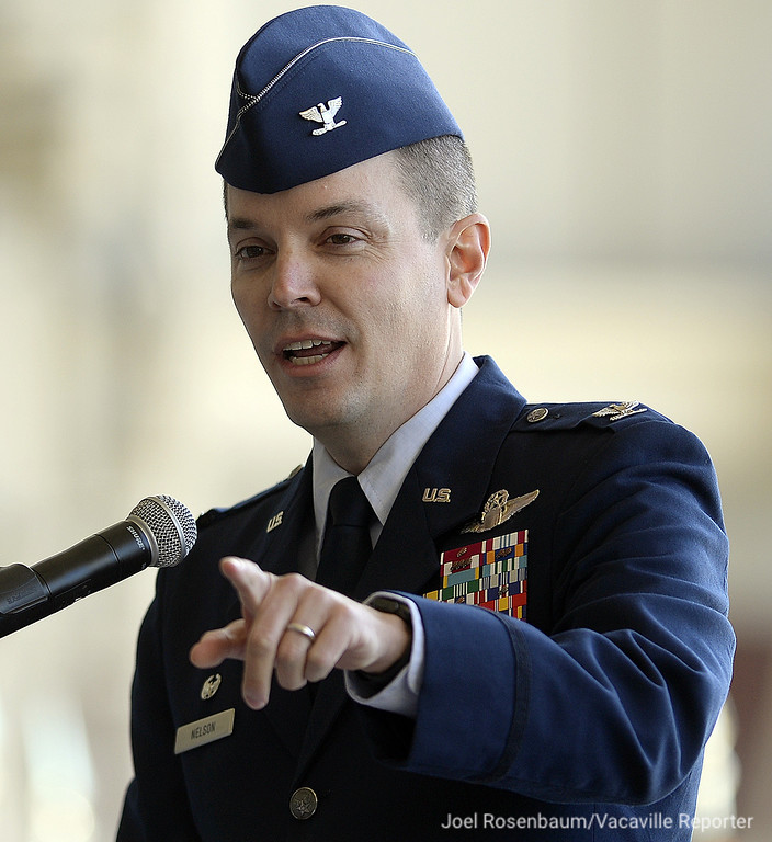 . New commander of the 60th Air Mobility Wing at Travis AIr Force Base, Col Jeffrey W. Nelson points out members of his family as he delivers his remarks during his Assumption of Command Ceremony Tuesday on Base.