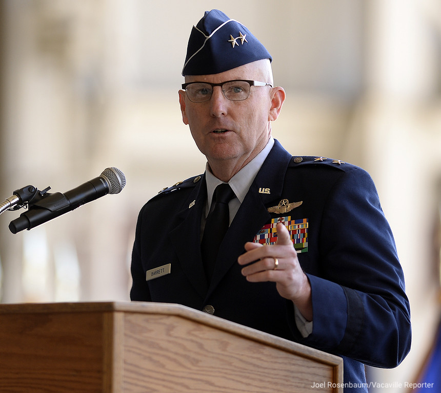 . United States Air Force Maj. Gen. Sam C. Barrett, commander of the 18th Air Force, Scott Air Force Base, Illinois delivers his remarks Tuesday as he leads an Assumption of Command Ceremony for new the new commander of the 60th Air Mobility Wing at Travis Air Force Base, Col. Jeffrey W. Nelson.