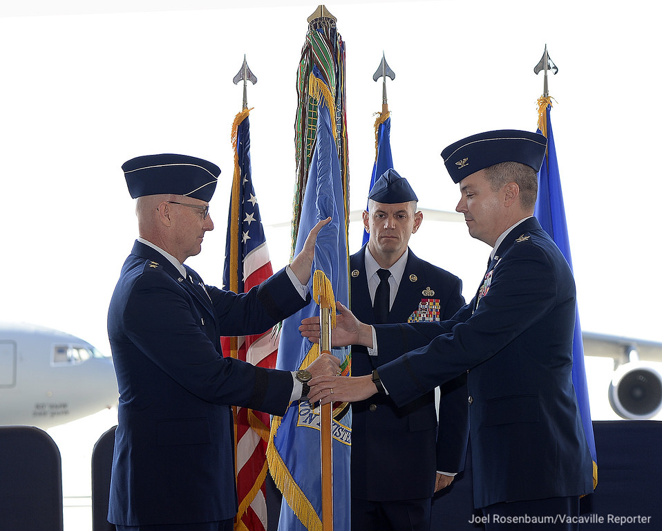 ". United States Air Force Maj. Gen. Sam C. Barrett, Commander, 18th Air Force passes the command guidon to Col. Jeffrey W. Nelson as he assumes command of the 60th Air Mobility Wing at Travis Air Force Tuesday during ceremonies on base. Col. Nelson takes over command after the base\'s previous commander, Col. Ethan Griffin was relieved of duty in August pending an investigation for alleged ""personal financial misconduct.\"""