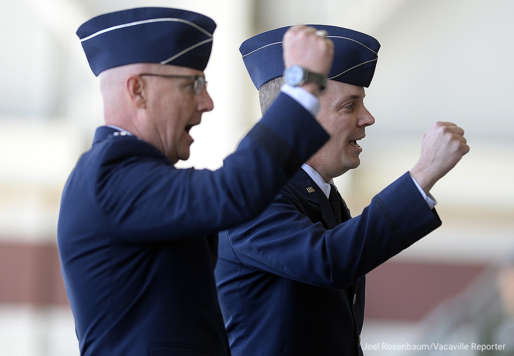 . United States Air Force Maj. Gen. Sam C. Barrett, Commander, 18th Air Force (left) and Col. Jeffrey W. Nelson sing the Air Force Song at the conclusion of an Assumption of Command Ceremony as Nelson takes over command of the 60th Air Mobility WIng at Travis Air Force Base Tuesday on base.