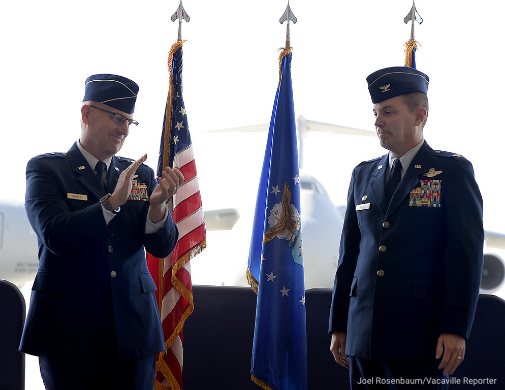 . United States Air Force Maj. Gen. Sam C. Barrett, Commander, 18th Air Force (left) applauds after Col. Jeffrey W. Nelson assumed command of the 60th Air Mobility Wing at Travis Air Force Tuesday during ceremonies on base.