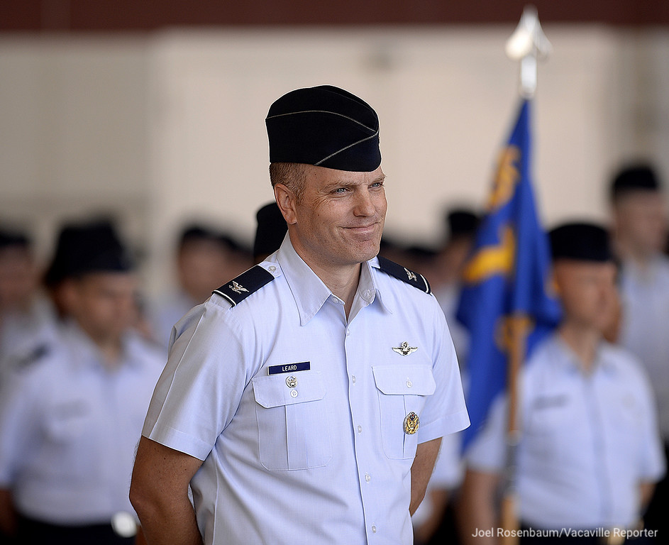 ". United States Air Force Col. Matthew A. Leard smiles as he is singled out by USAF Maj. Gen Sam C. Barrett during his remarks. Col Leard is the Vice Commander of the 60th Air Mobility WIng and was the base\'s interim commander after the previous commander, Col Ethan Griffin was relieved in August after he was placed under investigation for alleged ""personal financial misconduct.\"""