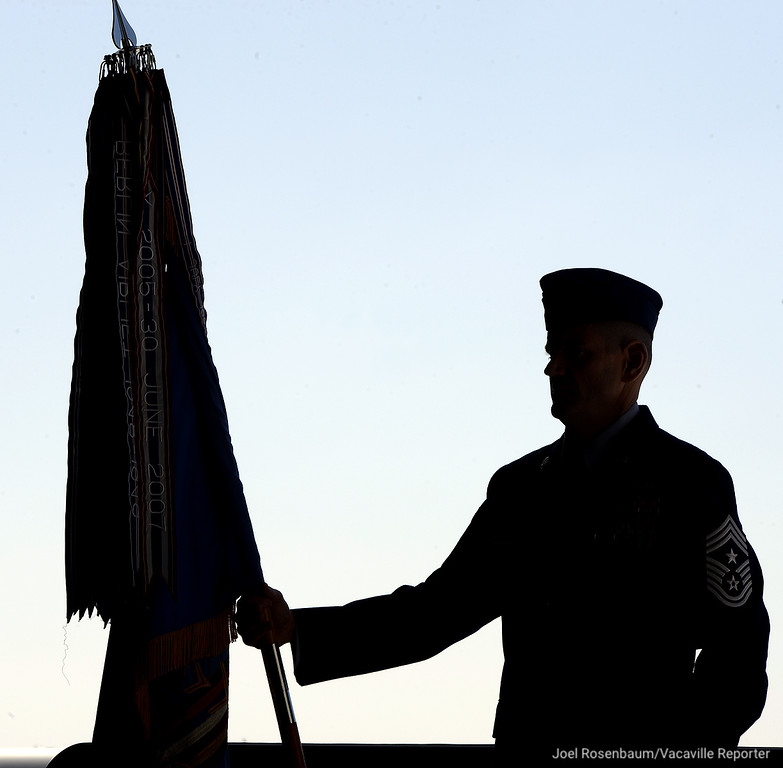 . United States Air Force Chief Master Sgt. Derek Crowder, command chief of the 60th Air Mobility Wing at Travis Air Force Base stands at ease as he holds the command guidon during an Assumption of Command Ceremony for new base commander, Col. Jeffrey W. Nelson Tuesday on base.