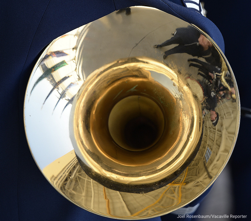 . The interior of the hangar is reflected in the bell of French horn held by a member of the United States Air Force Band of the Golden West during an Assumption of Command Ceremony for new base commander. Col. Jeffrey W. Nelson Tuesday on base.