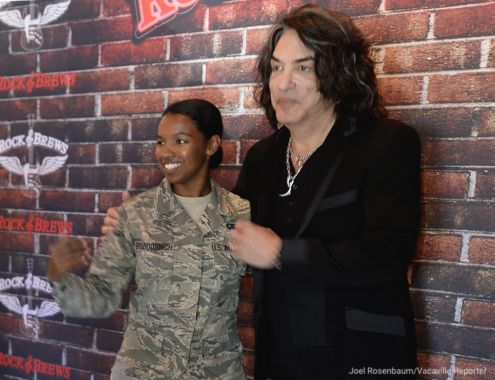 . United States Air Force Sr. Airman Salina Boodoosingh from Travis Air Force Base poses for a picture with KISS lead singer, Paul Stanley during a luncheon honoring both active duty and retired military at the new Rock & Brews Restaurant in Vacaville. In addition to the lunch a ceremonial ribbon was cut officially opening of the eatery.