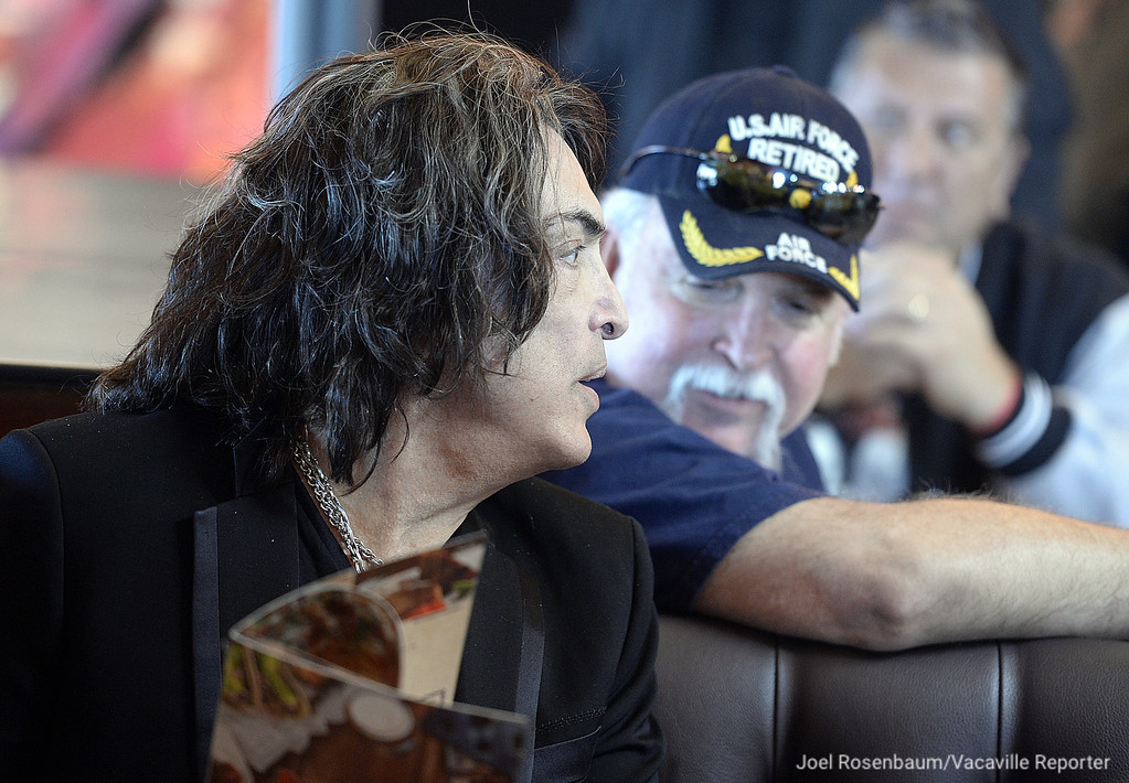 . Rock and Roll Hall-of-Famer, Paul Stanley of KISS speaks with Allen Hanson of Sacramento and a retired United States Air Force serviceman  at the grand opening of the new Rock & Brews Restaurant in Vacaville.