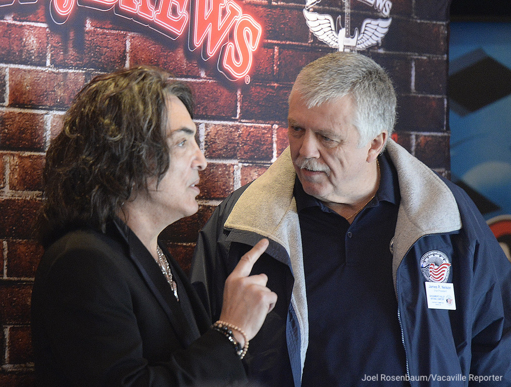 . Rock and Roll Hall-of-Famer, Paul Stanley of KISS speaks with James R. Nelson of Vacaville, Vice President of Sacramento Valley National Cemetery and a retired United States Air Force serviceman  at the grand opening of the new Rock & Brews Restaurant in Vacaville.