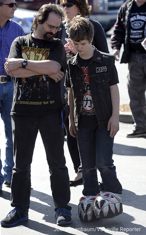 . KISS fan Kenny Moore and his son, Nick of Fremont  wait for a ribbon cutting ceremony for the Rock & Brews Restaurant in Vacaville that marked its grand opening Tuesday with a visit from Paul Stanley, co-founder of the band.