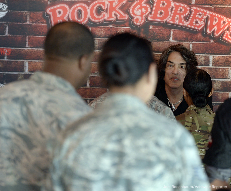 . Rock and Roll Hall-of-Famer, Paul Stanley of KISS speaks with service men and women from Travis Air Force Base at the grand opening of the new Rock & Brews Restaurant in Vacaville.