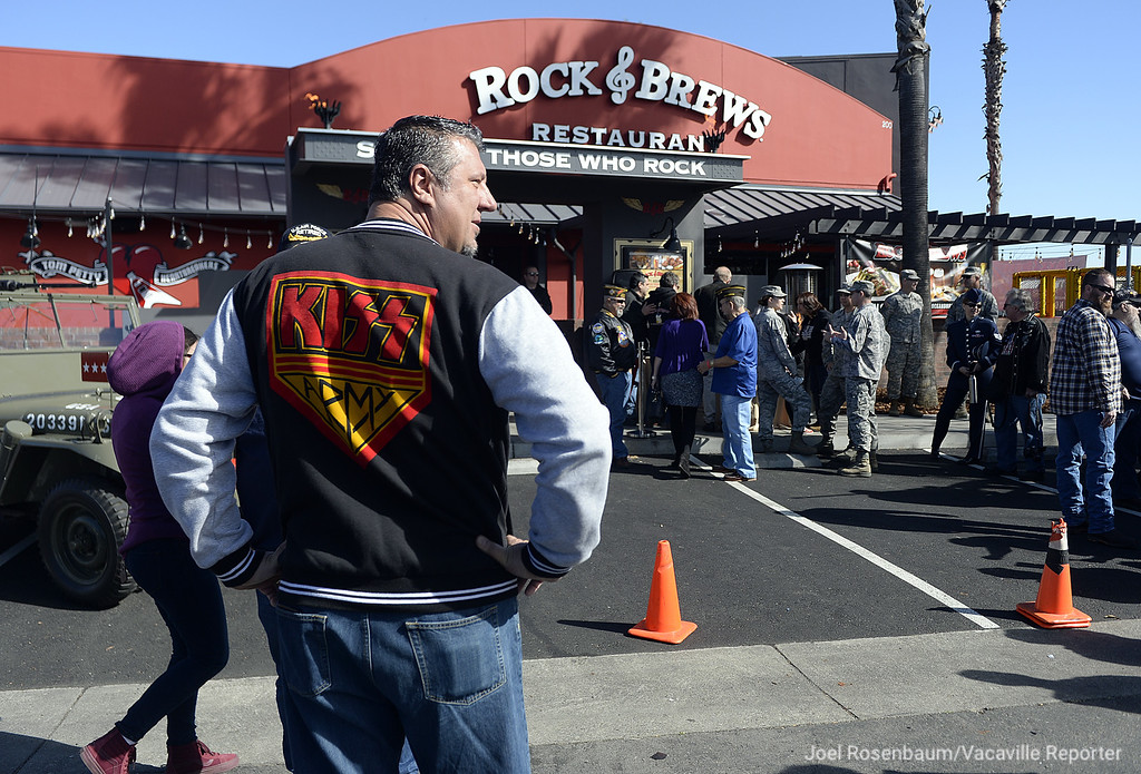 . KISS fan and retired serviceman from the United States Air Force, Christian Belsky of Sacramento waits to enter the new Rock & Brews Restaurant in the Vacaville Commons Shopping Center Tuesday during a special grand opening event that honored both active duty and retired military that featured a visit from rocker, Paul Stanley, who along with fellow KISS band mate, Gene Simmons are partners in the restaurant chain.