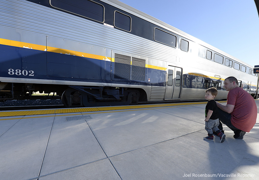 . Warren Green, 2 and his father, Brad watch as  Capitol Corridor train #538 departs the Fairfield-Vacaville Train Station for points east early Thursday evening as they attend a grand opening for the train station.