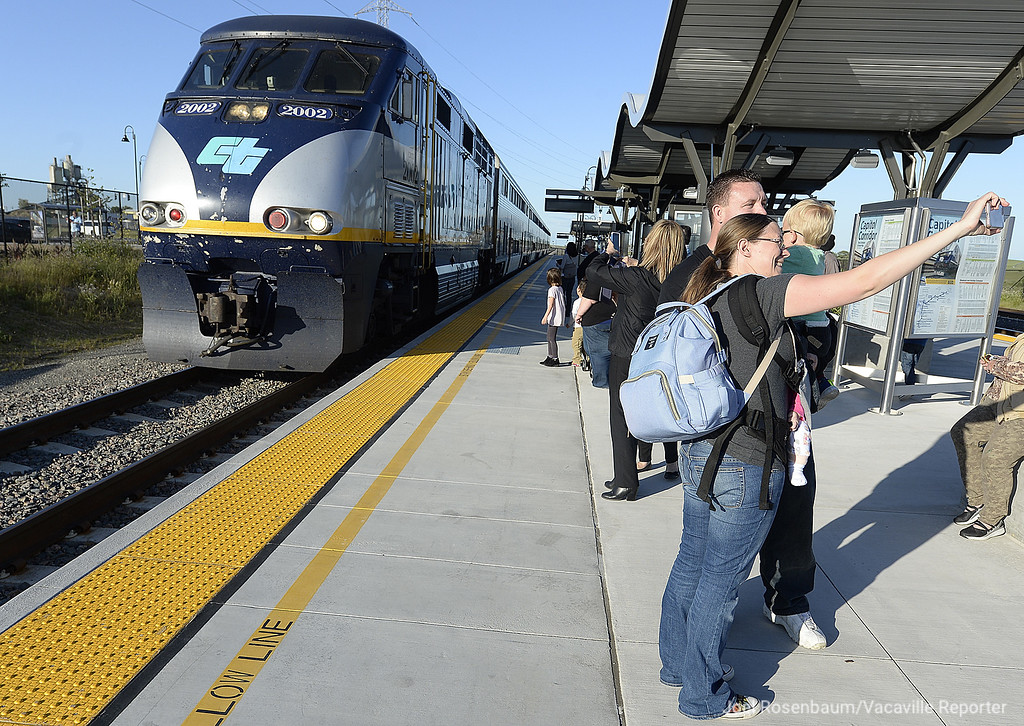 . The Wickham family of Cordelia pose for a selfie as Capitol Corridor Train #547 pulls into the platform at the new Fairfield-Vacaville Train Station after they attended a grand opening ceremony Thursday in Fairfield.