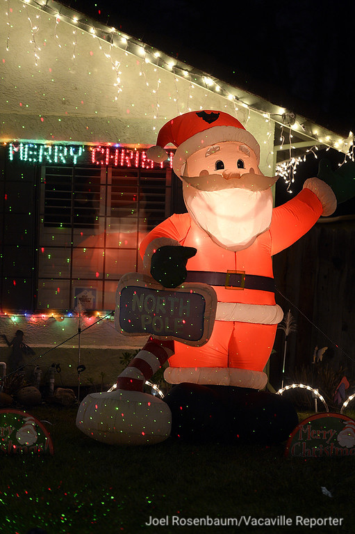 . A cheerful Santa greets visitors to Jim Purdy\'s home in the 300 block of Woodstock Circle in Vacaville.