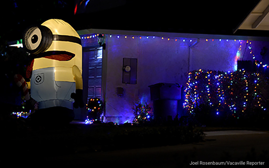 . A large minion stands greets sightseers along Shady Glen Avenue, also know as Lollypop Lane in Vacaville. Joel Rosenbaum -- The Reporter