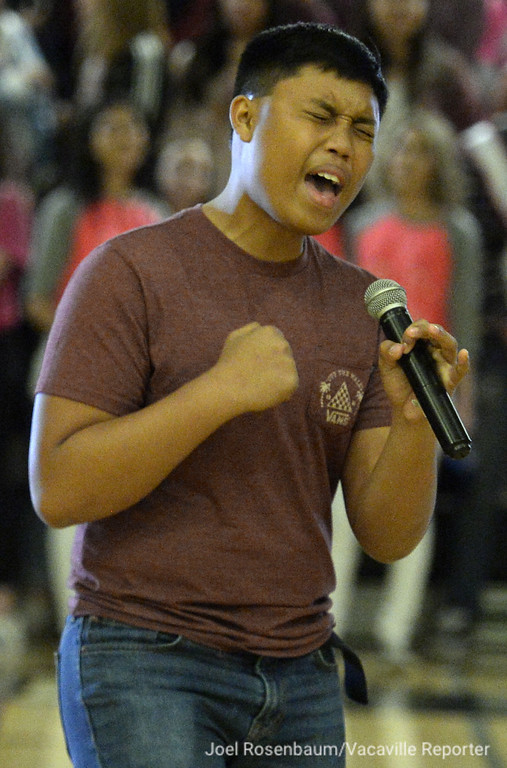 """. JC Espiritu, 16 a sophomore at Dixon High School  sings the Ed Sheeran song, \""""Thinking Out Loud\"""" to the cheers of his fellow students during the annual Sweethearts\' Rally Friday in the school\'s gymnasium."""