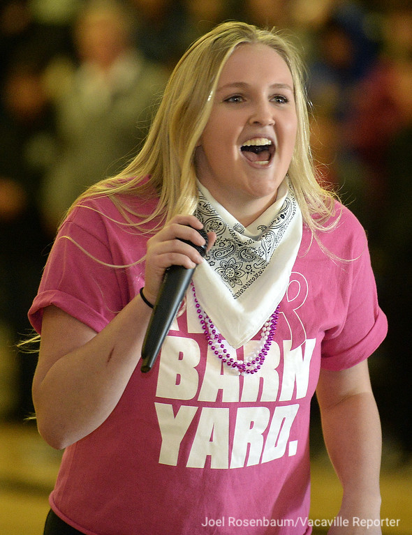 . Payton Vita, 18 a senior at Dixon High School fires up the crowd by leading them in the school cheer during the annual Sweethearts\' Rally Friday in the school\'s gymnasium.