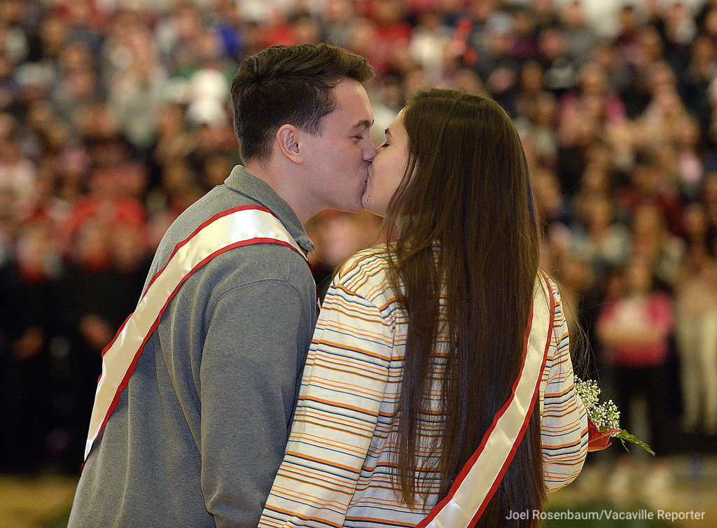 . Dixon High School seniors Matthew Roco, 17 and Taylor Garcia, 17 exchange a kiss as they are introduced as one of the nominated couples for Sweetheart king and queen during the annual Sweetheart Rally Friday in the gym at Dixon High School. The event was originally scheduled for last week but was postponed due to a disciplinary issue with a student who made a casual threat while talking with a friend on campus that was overheard by a third subject who reported to to staff at the school.