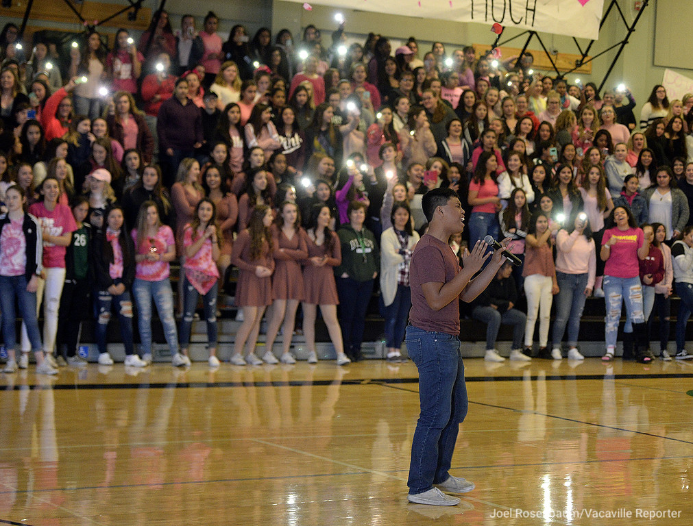 ". JC Espiritu, 16 a sophomore at Dixon High School  sings the Ed Sheeran song, ""Thinking Out Loud\"" to the cheers of his fellow students during the annual Sweethearts\' Rally Friday in the school\'s gymnasium."