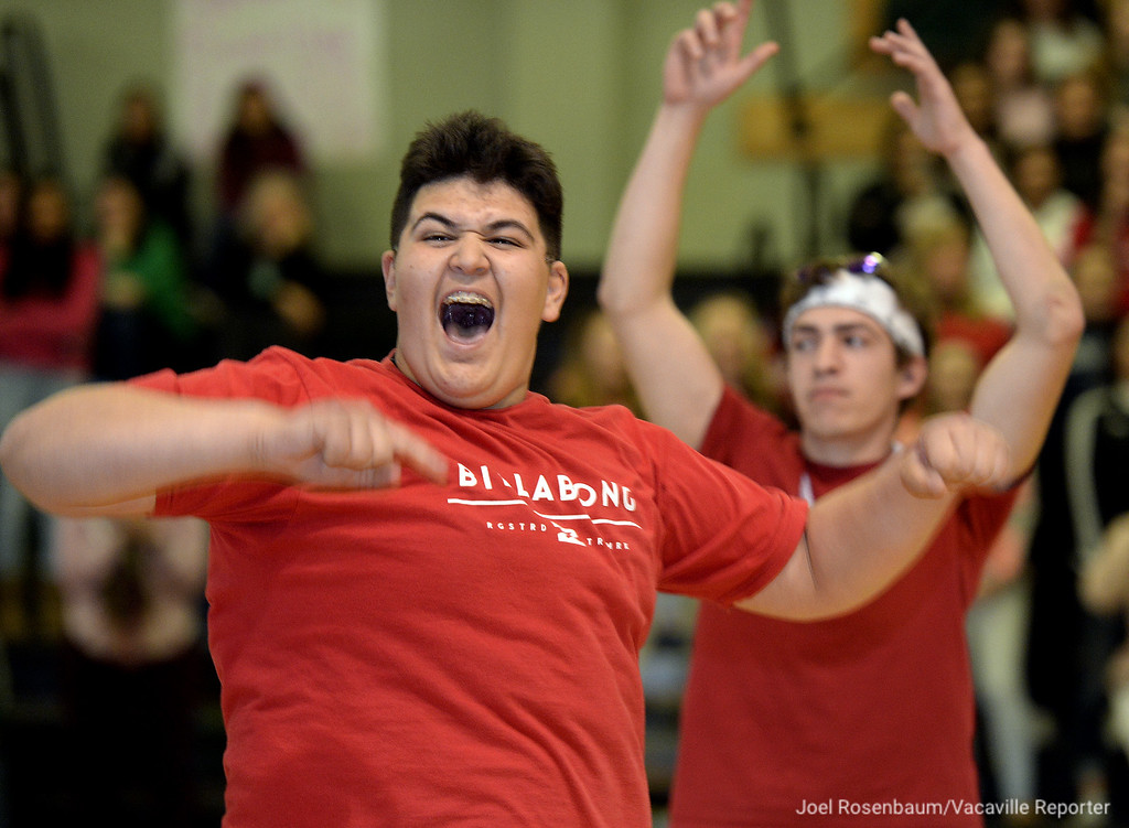 . Dixon High School\'s Guero Delgado, 16 a sophomore (left) and Brian Schneider, 18 a senior celebrate their victory after winning a game of volleyball toss, where the object of the game was to throw ball into a trash cans during the school\'s annual Sweethearts\' Rally, Friday at the gym.