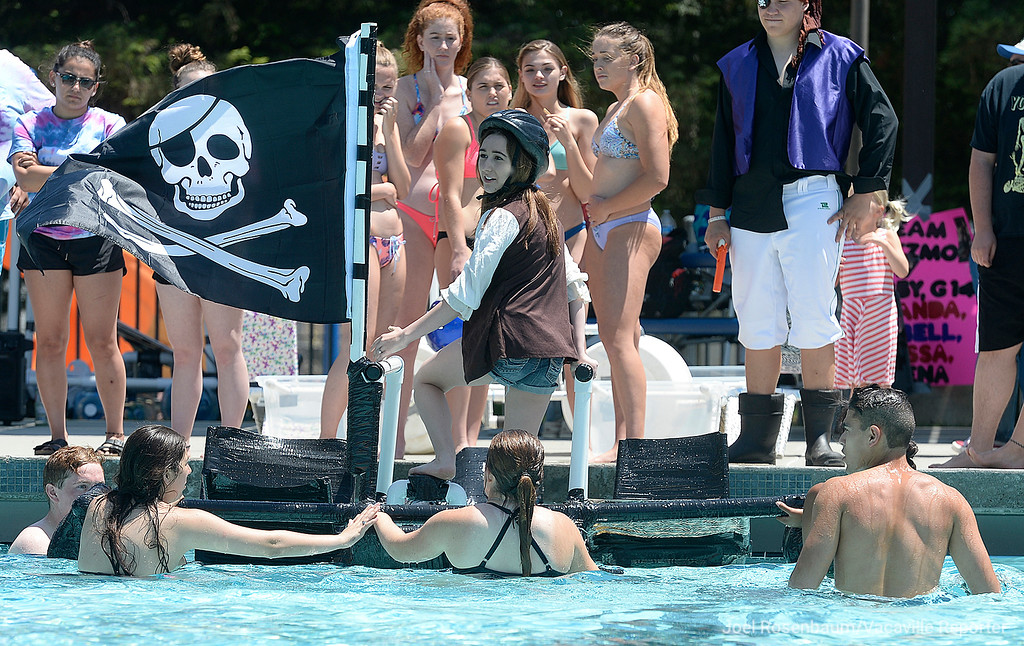 . Physics student Katie Hurtado, 17 a senior at Dixon High School signals to teacher, Kim McGreevey that she is ready to begin her attempt to walk across the pool.