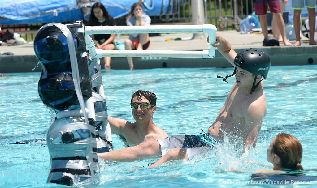 ". Piloting his team\'s entry dubbed ""The Brass Monkey,\"" physics student Taylor Schene, 18  a senior at Dixon High School looses his  balance  and gets wet as he competes in the 16th annual Walk on Water competition Tuesday at the Pat Granucci Aquatic Center in Hall Park."