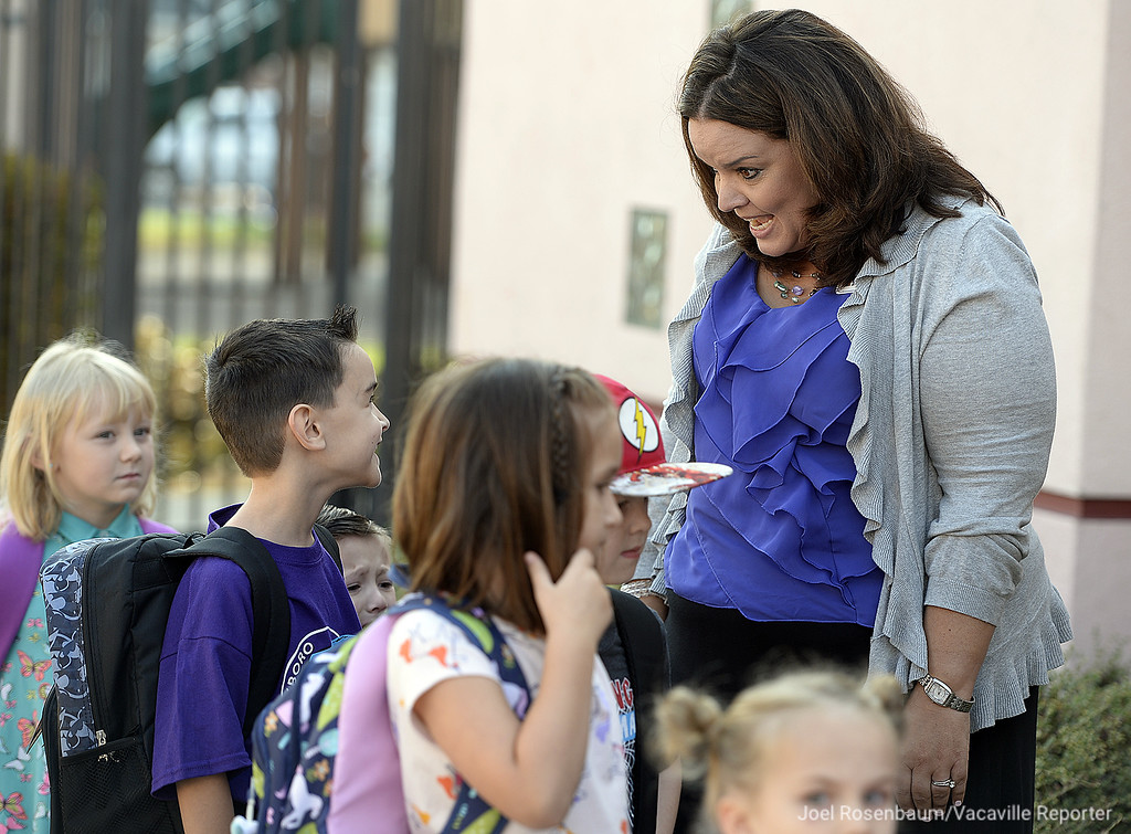 . Foxboro Elementary School principal Samantha Chizauskie engages in an animated discussion with new kindergarten students as they walk to class on the first day of school.