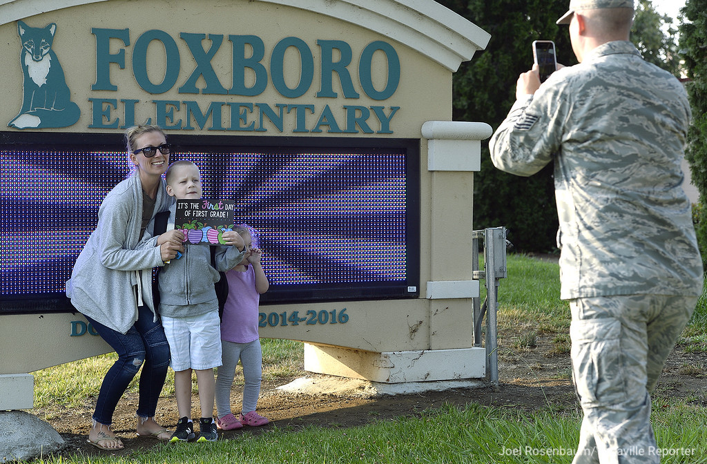 . New Foxboro Elementary School first grader, Robby Nolen (second from left) 6 of Travis Air Force Base poses in front of the  with his mom, Sabrina (left) and little sister, Harlyn, 2 as his dad, Robert snaps the picture in school sign Wednesday on the first day of school in the Travis Unified School District.