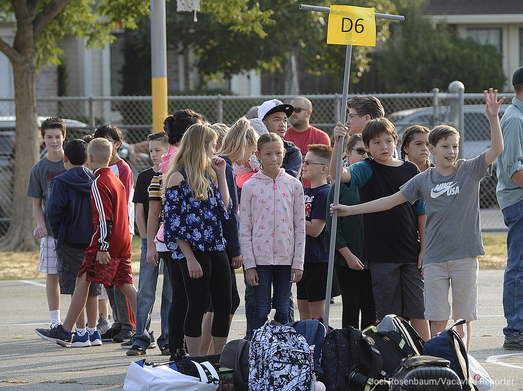 . Students in Jennifer Barnett\'s sixth grade class at Foxboro Elementary School line up on the playground before they started their first day of class.