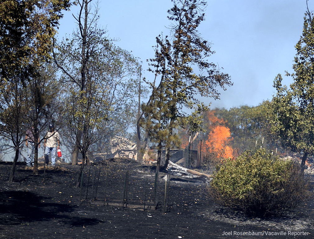 . Flames erupt at a home in the 4000 block of Skyhawk Lane Saturday in English Hills. The owner of the home, Jeff Carmichael was home at the time of blaze and was able to save several of his pets, but lost his home. Joel Rosenbaum -- The Reporter