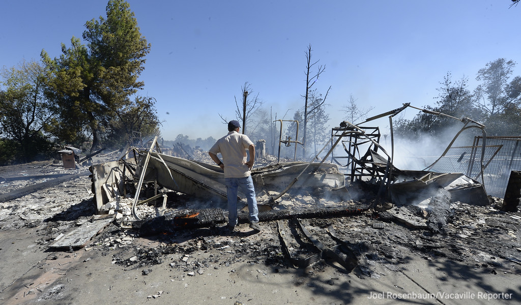 . Homeowner, Jeff Carmichael of Vacaville examines his home in the 4000 block of Skyhawk Lane after it was destroyed by a five-alarm, 65 acre grassfire that began late Saturday morning. Joel Rosenbaum -- The Reporter
