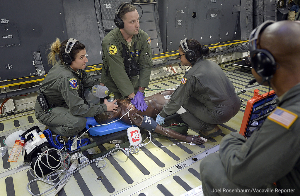 . United States Air Force aeromedical evacuation personnel perform cpr on a patient while taking part in readiness exercise Thursday in the skies above Northern California.
