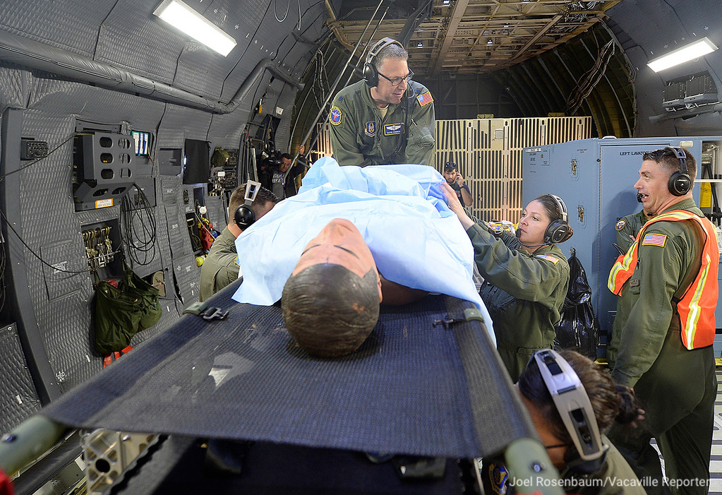 . United States Air Force aeromedical evacuation personnel perform a medical procedure on a patient while taking part in readiness exercise Thursday in the skies above Northern California.