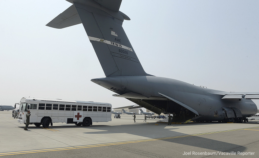 """. An ambulance backs up to the ramp of a C-5M Super Galaxy in order to receive \""""patients\"""" after they were transported back to Travis Air Force Base Thursday at the conclusion of aeromedical evacuation training exercise."""
