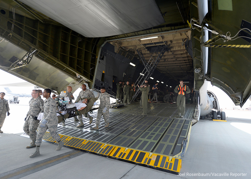 . Members of the Travis Air Force Base ground crew off load patients to a waiting ambulance at the conclusion of a readiness exercise Thursday at the conclusion of aeromedical evacuation training exercise.