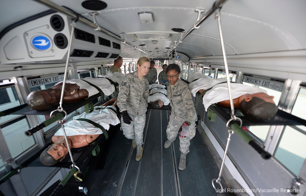 ". Members of the Travis Air Force Base ground load ""patients\"" onto a waiting ambulance at the conclusion of a readiness exercise Thursday at the conclusion of aeromedical evacuation training exercise."
