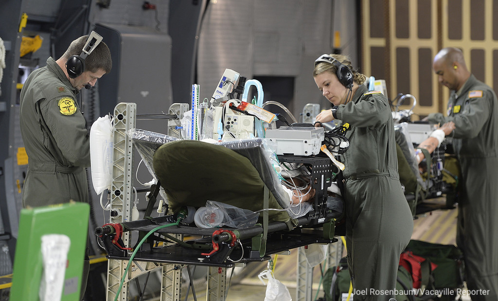 . Members of an United States Air Force Critical Care Air Transport Team take part in a training exercise aboard a Travis Air Force Base C-5M Super Galaxy. The personnel in this unit are responsible for caring for Intensive Care patients and includes a doctor, flight nurse and respiratory therapist.