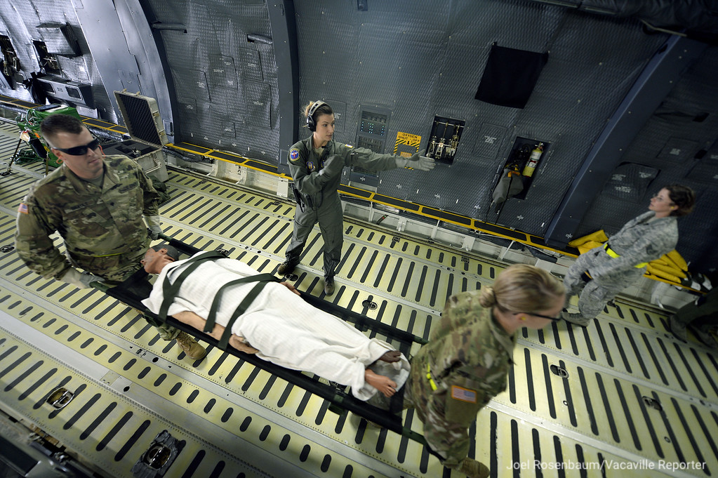 . Under the direction of United States Air Force aeromedical evacuation squadron member, Travis Air Force Base ground crew personnel load a patient onto a C-5M Super Galaxy during a readiness exercise Thursday on flightline.