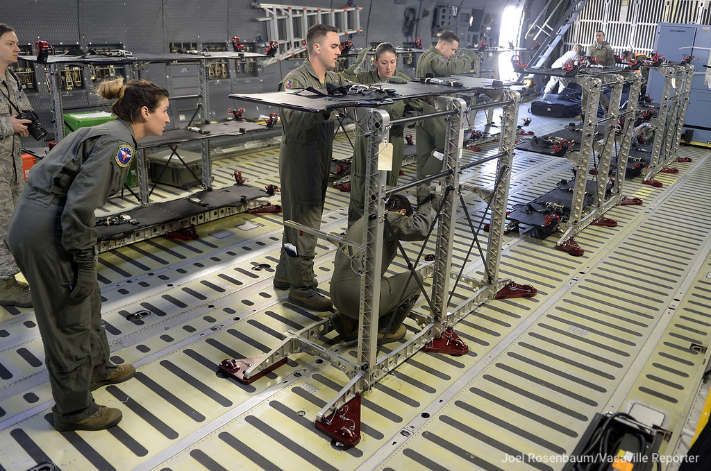 . Aeromedical evacuation squadron members set up the necessary equipment in the cargo bay of Travis Air Force Base C-5M Super Galaxy that will allow them to properly care for patient that will be flown aboard the air craft during a training exercise Thursday on base and in the air.