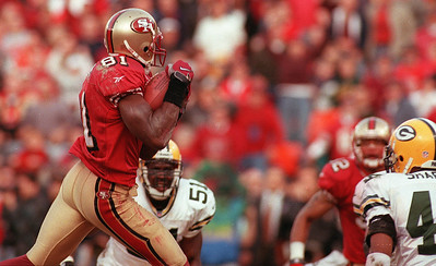 San Francisco Forty Niner wide receiver, Terrell Owens hauls in the game-winning touchdown in the closing seconds of the Niners 30-27 victory over the Green Bay Packers in the NFC wild-card game in January 1999.