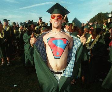 "WIth a ""Super Man"" symbol emblazened on his chest, Vanden High School graduate, Brian Huddleston of Vacaville, Calif. flashes the crowd at the conclusion of the the school's commencement cermonies for the class of 1999 on Thursday June 10, 1999."