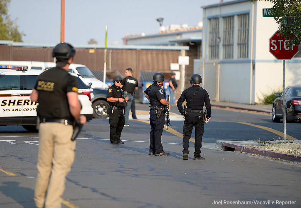 . Officers from the Vacaville and Fairfield Police Departments and Solano County Sheriff\'s office maintain a perimeter outside E. Gary Vaughn Gymnasium at Armijo High School following a shooting at Bell Avenue and Washington Street killed a 16 year old boy and critically injured an 18 year old man.