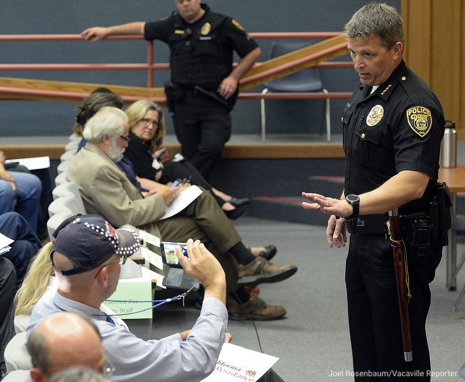. Dixon Police Chief, Robert Thompson speaks with Arthur Schaper (left), Organization Director for Mass Resistance after Schaper created a disturbance before Tuesday\'s city council meeting.