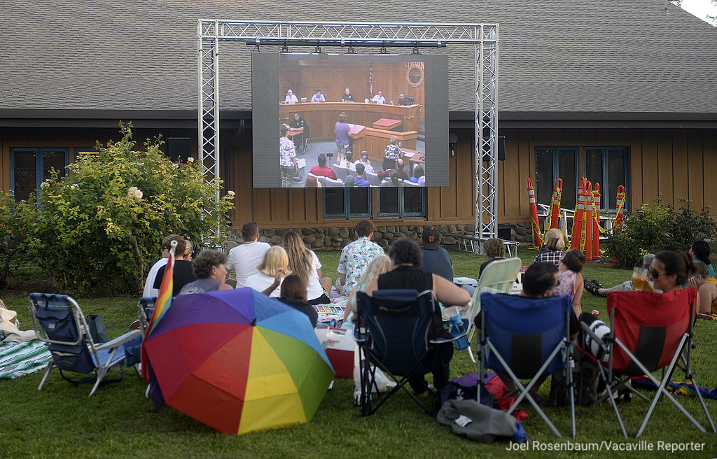 . Supporters of the LBGT community gather on the lawn outside of Dixon City Hall to watch Tuesday night\'s city council meeting.