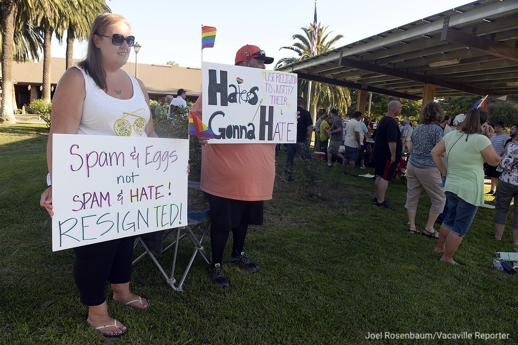 . Lydia and Steven Hernandez of Dixon show their support for the LBGT community as they stand with fellow supporters outside of Dixon City Hall before Tuesday\'s city council meeting.