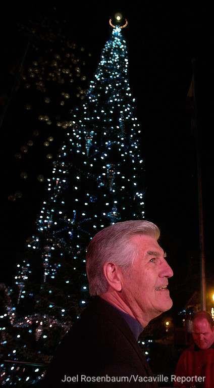 . Former Reporter owner/publisher Richard Rico looks out over the crowd after he threw the switch to light the tree during the 25th anniversary Merriment on Main celebration. Rico started the tradition as a way of giving back to Vacaville. Joel Rosenbaum/The Reporter, Vacaville