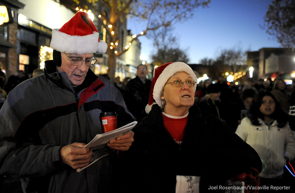 . Bill & Jackie Hampton, Suisun City sing Christmas songs along with the Mobility from Travis Air Force Base during the 31st Annual Merriment on Main celebration on Tuesday, December 3, 2013. Joel Rosenbaum/JRosenbaum@TheReporter.com