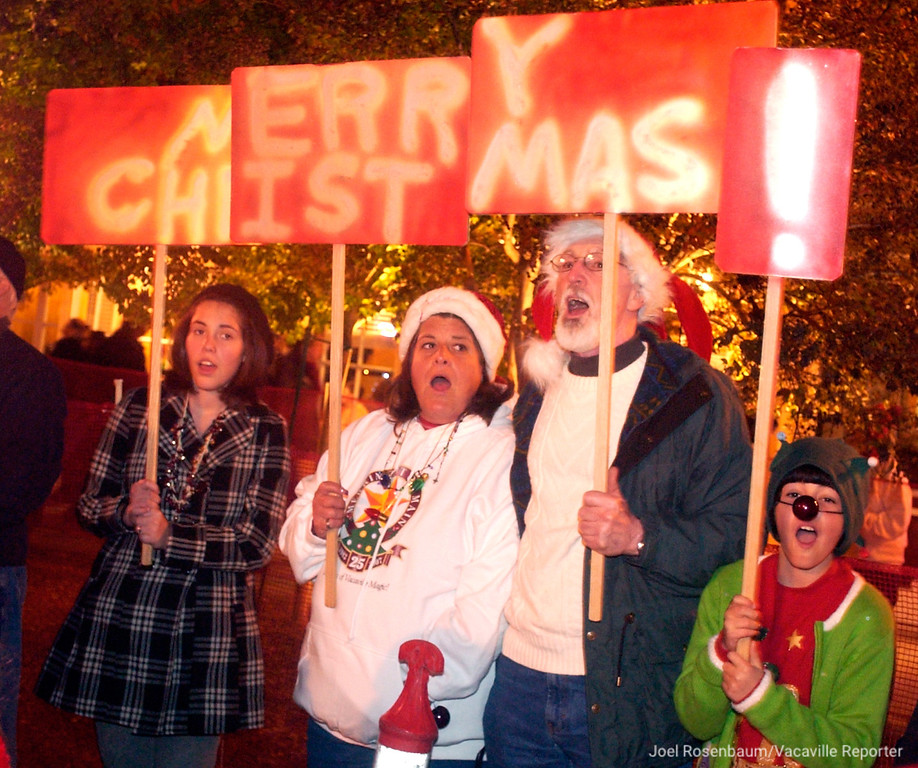 """. The Hendricksen family (from left) Ali, 14, Althea, Terry and Molly, 9 get into the spirit of the season as they sing along to \""""Rudolph the Red-Nosed Reindeer during the 26th annual Merriment on Main Celebration. Joel Rosenbaum/jrosenbaum@thereporter.com"""