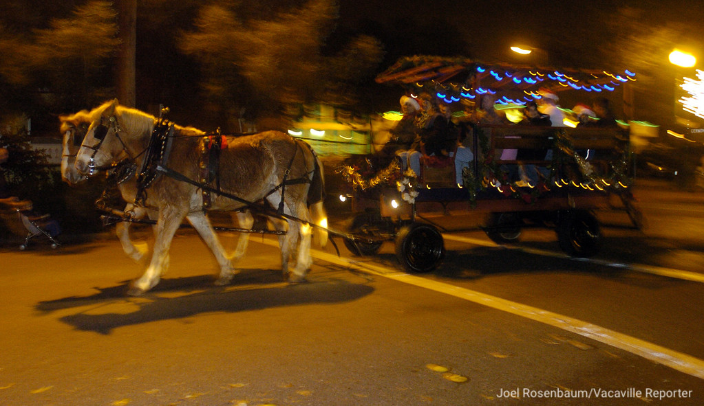 . A horse-drawn carriage from Buzzard\'s Roost Ranch in Winters, California ferries people along Main Street during the 26th annual Merriment on Main on Tuesday, December 2, 2008. Joel Rosenbaum/jrosenbaum@thereporter.com